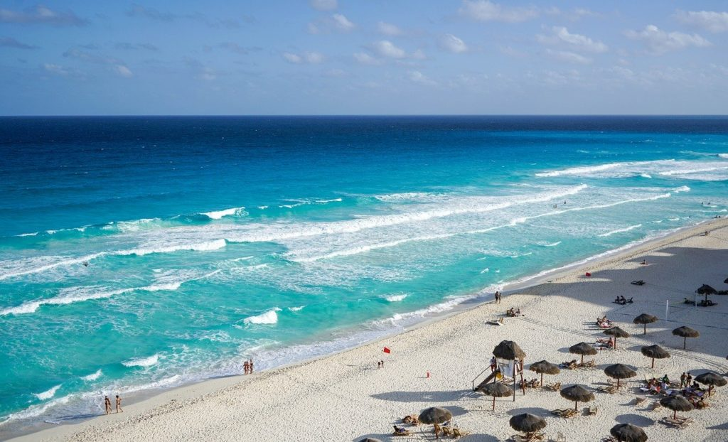 Crystal clear blue water on Cancun beach in  Mexico