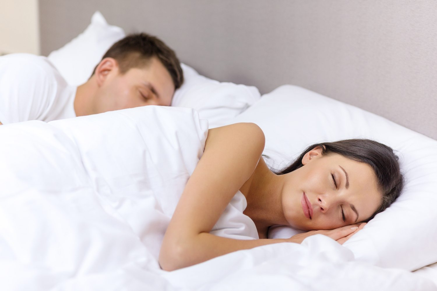 Couple Sleeping at a Hotel