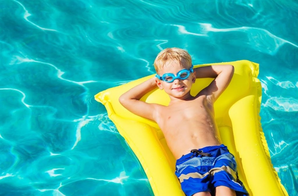 Boy on Raft in the Pool