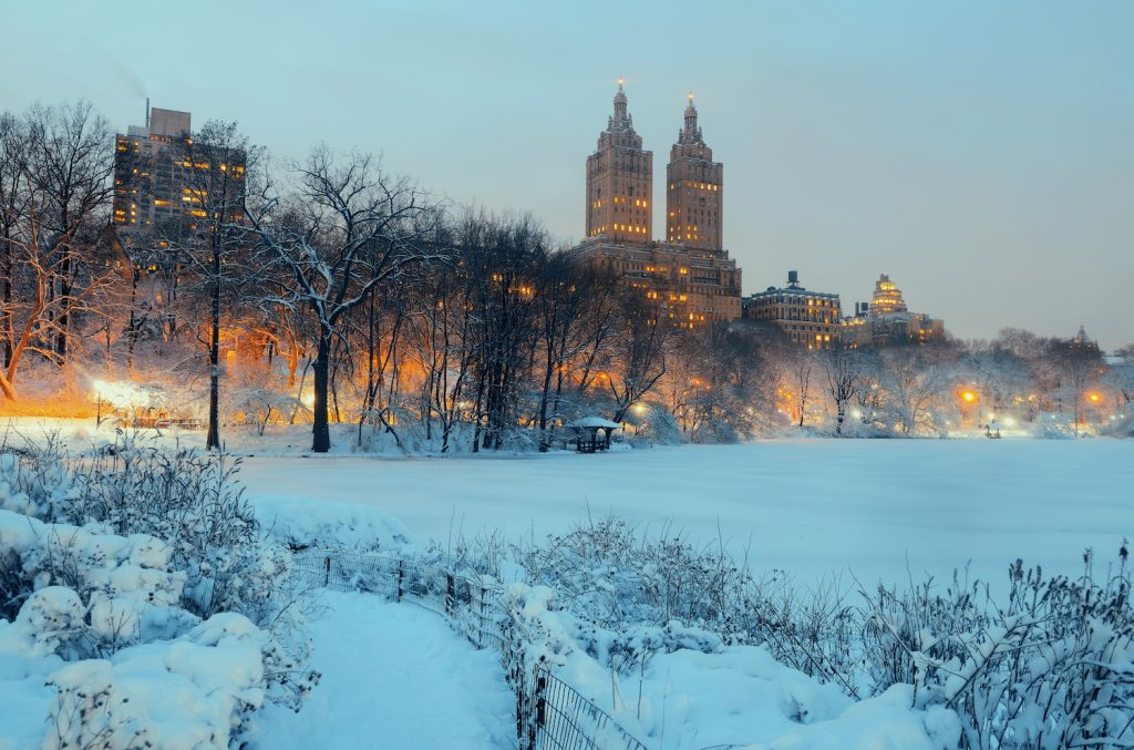 Central Park winter at night with skyscrapers in midtown Manhattan New York City
