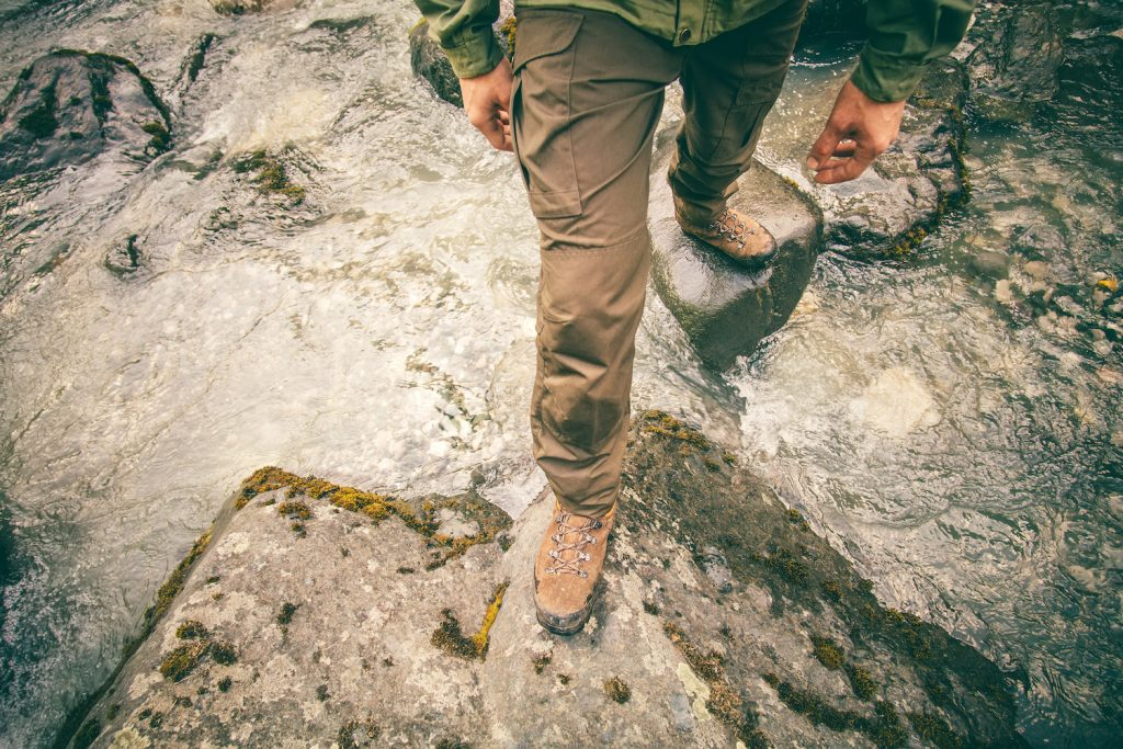 Man Hiking Over River