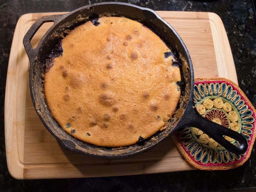 blueberry cobbler cooked in a cast iron skillet