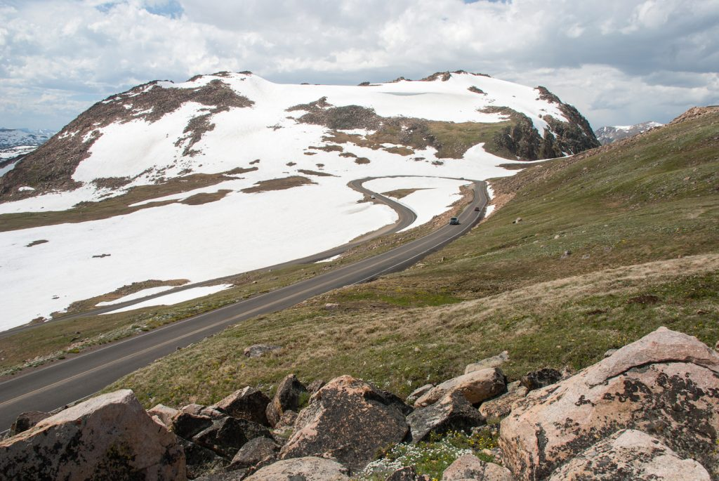 Snow drapes the mountain slopes along the Beartooth Highway