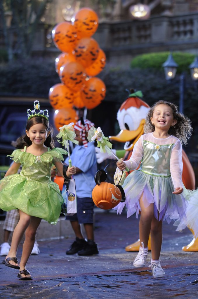 Girls Trick-or-treating at Mickey's Not-So-Scary Halloween Party