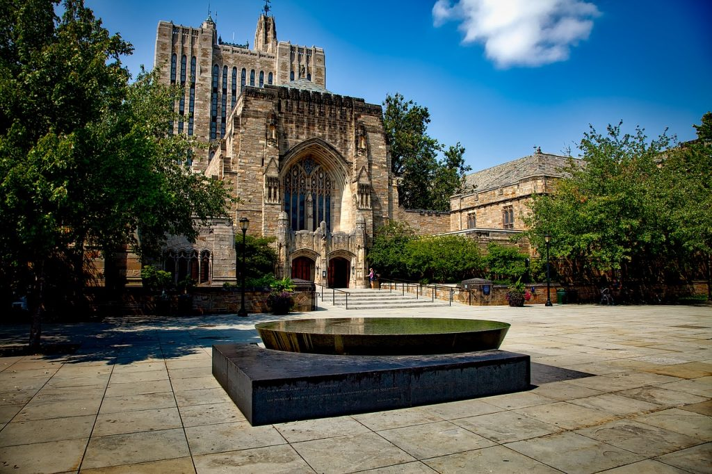 Outside view of the Yale University building, with a small fountain in front