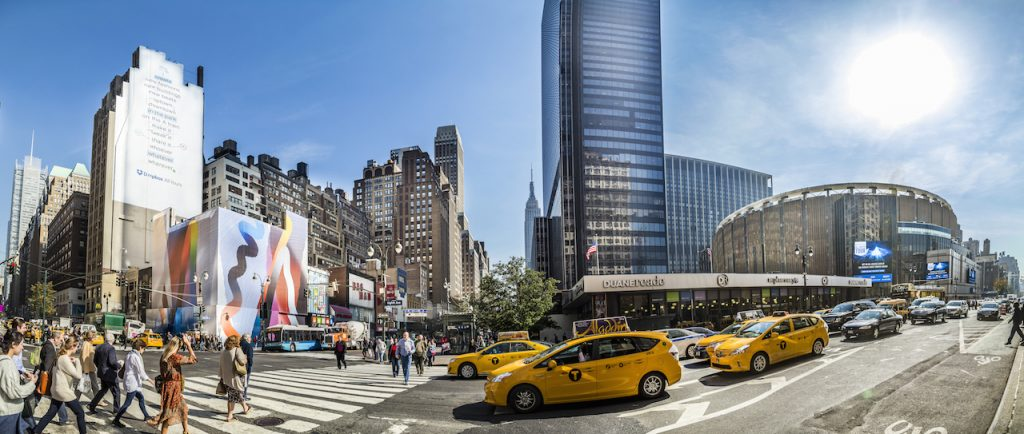 panorama view of busy street on Madison Square Garden