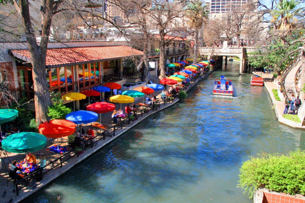 San Antonio River Walk with colorful umbrellas lining walkway in Texas