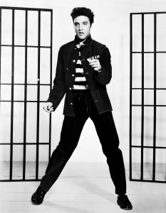 Black and white photograph of young Elvis Presley dancing