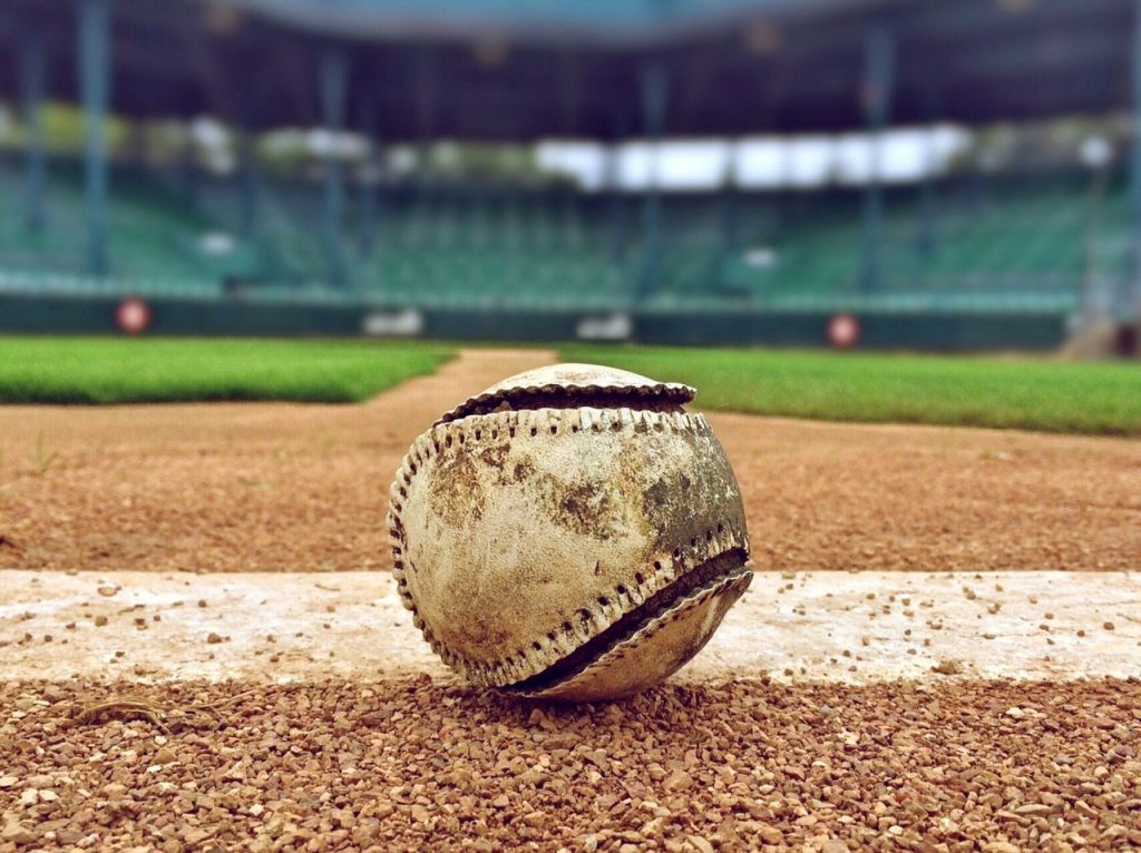 a tethered baseball sitting on a baseball field