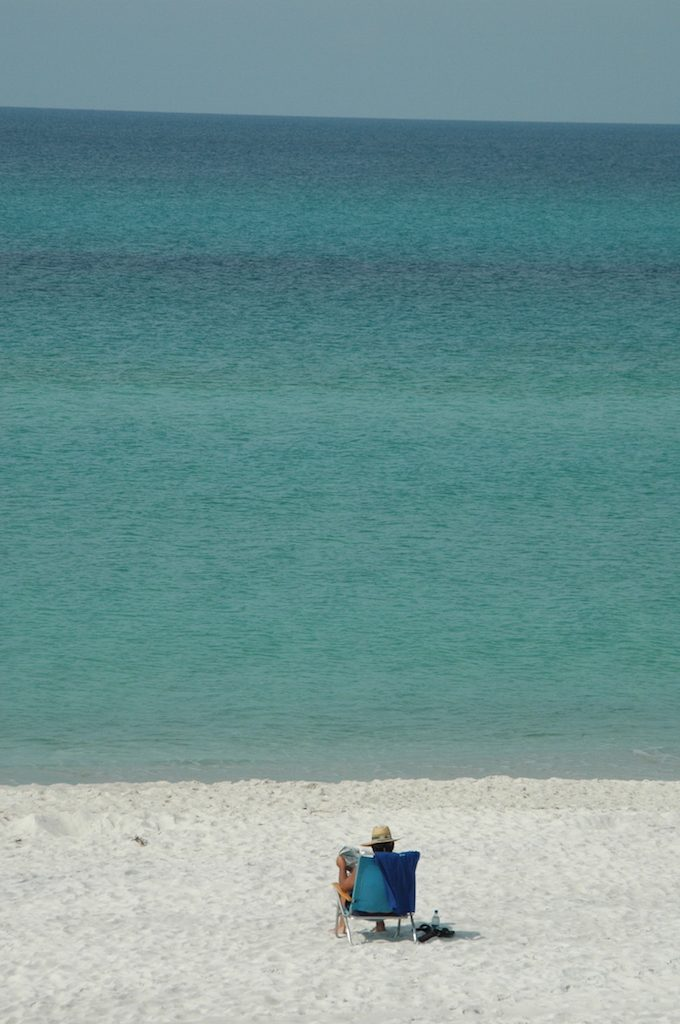 Person sitting in beach chair in the sand at Beaches of South Walton Florida 2008 ** Note: Slight blurriness, best at smaller sizes