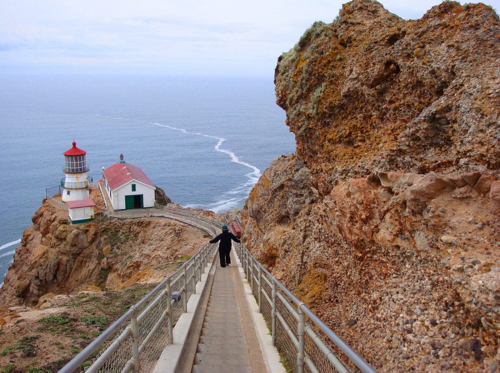 Woman walking down stairs to Point Reyes Lighthouse in California