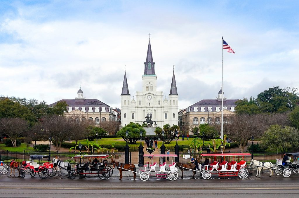 horse and carriages in front of Jackson Square in New Orleans