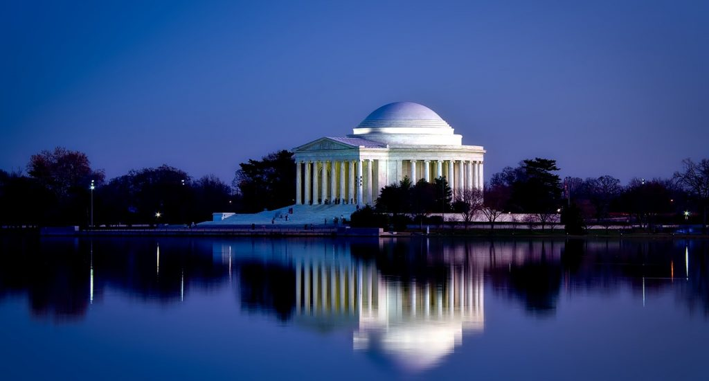 Jefferson Memorial in Washington DC at night time, with building reflection on the water