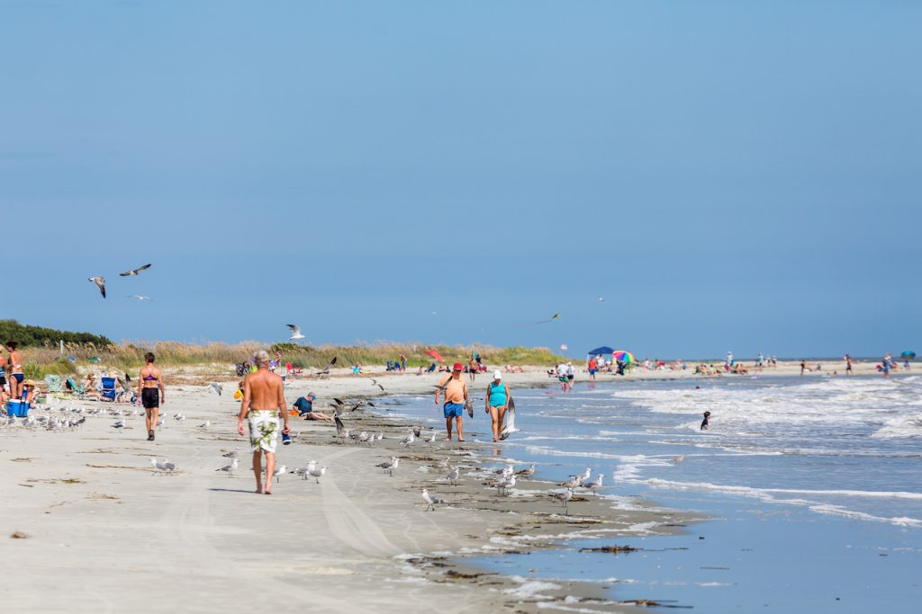 People walking on the beach at St Simons Island.