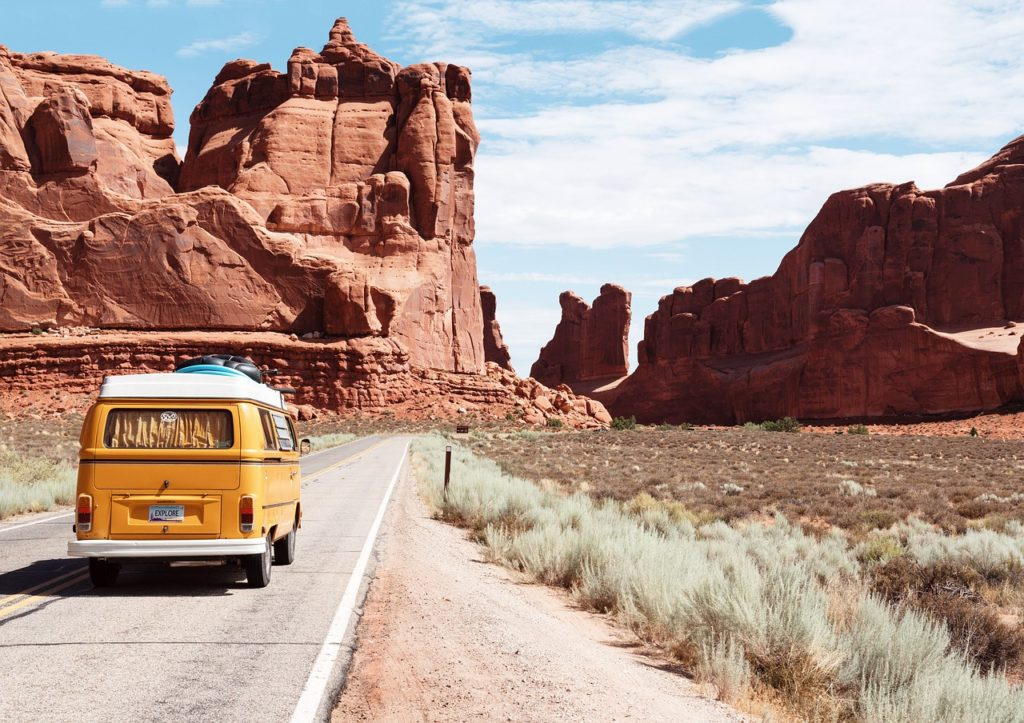 yellow van driving into a national park