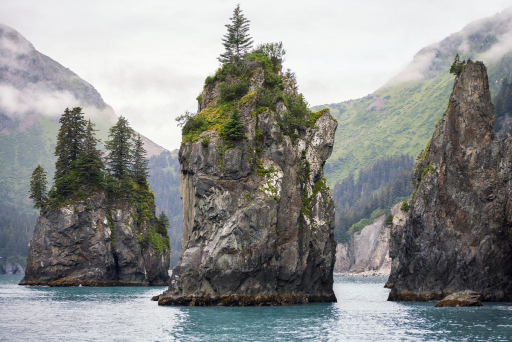 A seascape photograph of sea stacks in Kenai Fjords National Park in Alaska,