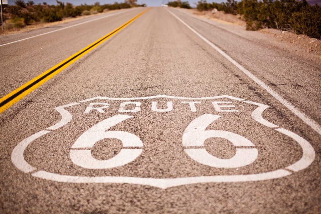 Painted Route 66 sign on the floor in the middle of the highway
