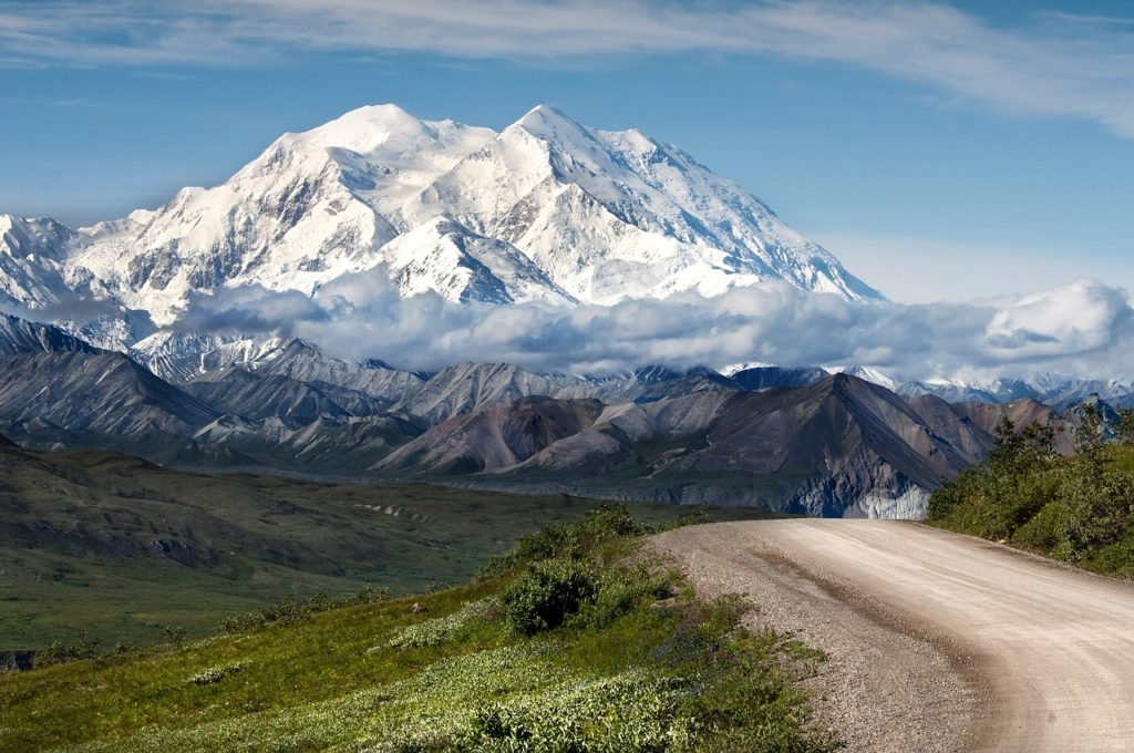 view of Denali Park Road off to the right with mountains inside Denali National Park & Preserve in the distance