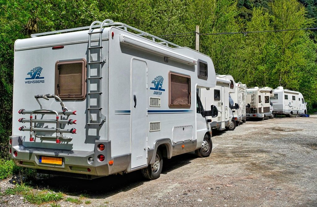 several rv's in a row in an rv campground